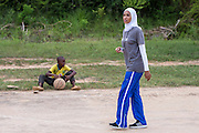 VSO ICS volunteer and qualified basketball coach Asma Elbadawi during an evening training session with male and female students from Lindi secondary school. Part of the VSO / ICS Elimu Fursa project (Opportunities in Education) Lindi, Lindi region. Tanzania.