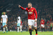Wayne Rooney Forward of Manchester United points at the linesman with blood on his face during the EFL Cup Quater-Final between Manchester United and West Ham United at Old Trafford, Manchester, England on 30 November 2016. Photo by Phil Duncan.