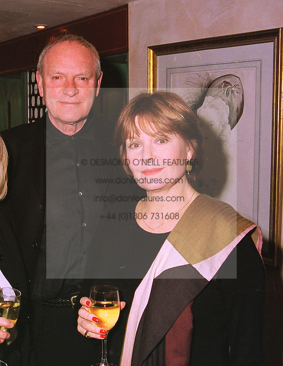 MR JULIAN GLOVER and his wife actress ILA BLAIR, at a party in London on 27th January 1999.MNM 16 2oro