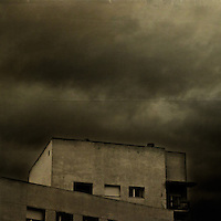 Dark clouds over a modern building