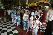 Myanmar, Sagaing, Kaung Hmu daw Pagoda. Shin Pyu Ceremony - Ordination ceremonary for Myanmar Buddhists Children are joining the monastery
