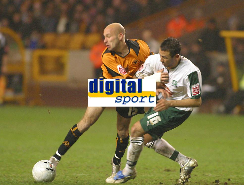 Photo: Dave Linney.<br />Wolverhampton Wanderers v Plymouth Argyle. The FA Cup Wolves's .Denes Rosa (L) can find no way through the Plymouth defence in the shape of  Hasney Aljofree<br />07/01/2006.