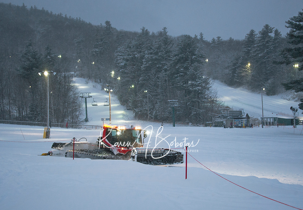 A groomer heads back to the garage after working the trails at Gunstock for night skiing Tuesday evening.  (Karen Bobotas/for the Laconia Daily Sun)
