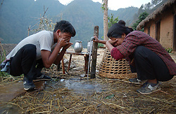 "RUKUM DISTRICT, NEPAL, APRIL 21, 2004:  Maoist insurgents wash up before beginning their walk through the mountains to a mobile training camp in Rukum district April 21, 2004.    Analysts and diplomats estimate there about 15,000-20,000 hard-core fighters, including many children and women, backed by 50,000 ""militia"".  In their remote strongholds, they collect taxes and have set up civil administrations, and ""people's courts"" to settle rows. They also raise money by taxing villagers and foreign trekkers. Though young, they are fearsome fighters and  specialise in night attacks and hit-and-run raids. They are tough in Nepal's rugged terrain, full of thick forests and deep ravines and the 150,000 government soldiers are not enough to combat this growing movement that models itself after the Shining Path of Peru. (Ami Vitale/Getty Images)"