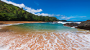 Sand and surf at Lumahai Beach, Island of Kauai, Hawaii