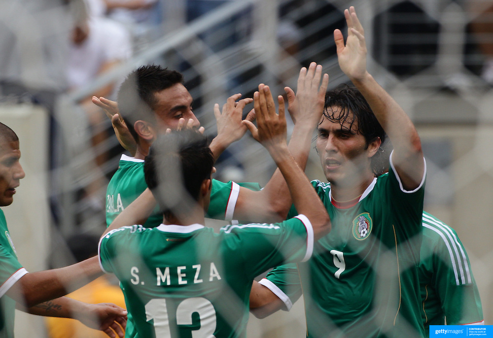 Aldo De Nigris, Mexico (right) celebrates his first goal during the Mexico V Wales international football friendly match at MetLife Stadium, East Rutherford, New Jersey, 23rd May 2012. Photo Tim Clayton
