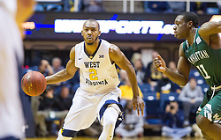 Nov 28, 2016; Morgantown, WV, USA; West Virginia Mountaineers guard Jevon Carter (2) dribbles up the floor during the first half against the Manhattan Jaspers at WVU Coliseum. Mandatory Credit: Ben Queen-USA TODAY Sports