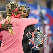 Serena Williams, USA, embraces Victoria Azarenka, Belarus, after winning the Women's Singles Final at the US Open, Flushing. New York, USA. 8th September 2013. Photo Tim Clayton