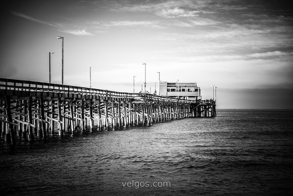 Newport Beach Pier in Orange County Southern California. Located on Balboa Peninsula in Newport Beach, Newport Pier is one of the most popular attractions in Orange County. Black and white photo is high resolution.