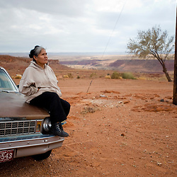 Despite a power line that runs to her neighbors house,  Arlene Jasper Begay still cannot get electricity in her mobile home.