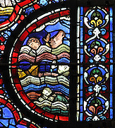 Drowned bodies of men and animals in the waves at the beginning of the flood, from the Life of Noah stained glass window, 13th century, in the nave of Chartres cathedral, Eure-et-Loir, France. Chartres cathedral was built 1194-1250 and is a fine example of Gothic architecture. Most of its windows date from 1205-40 although a few earlier 12th century examples are also intact. It was declared a UNESCO World Heritage Site in 1979. Picture by Manuel Cohen