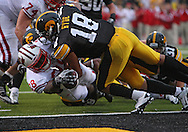 October 23 2010: Wisconsin Badgers running back Montee Ball (28) just gets the ball over the goal line for a touchdown on an 8 yard run as Iowa Hawkeyes cornerback Micah Hyde (18) tackles him during the second half of the NCAA football game between the Wisconsin Badgers and the Iowa Hawkeyes at Kinnick Stadium in Iowa City, Iowa on Saturday October 23, 2010. Wisconsin defeated Iowa 31-30.
