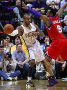 March 14, 2012; Indianapolis, IN, USA; Indiana Pacers shooting guard Dahntay Jones (1) dishes the ball off as Philadelphia 76ers small forward Andre Iguodala (9) defends at Bankers Life Fieldhouse. Mandatory credit: Michael Hickey-US PRESSWIRE