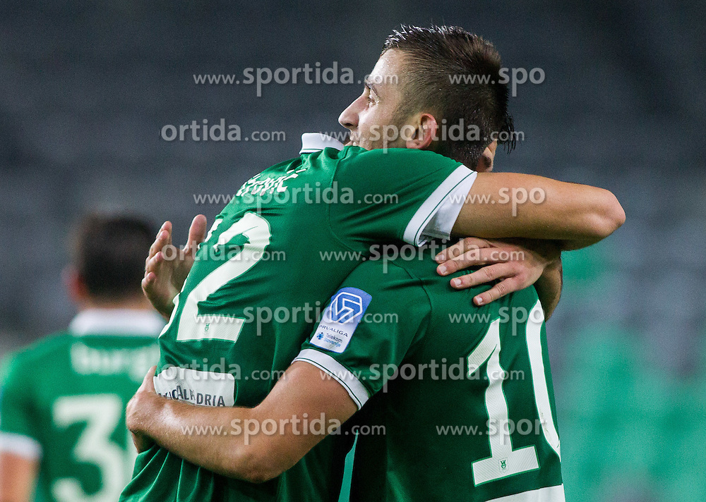 Nemanja Mitrovic #32 of Olimpija and Andraz Sporar #10 of Olimpija celebrate after second goal during football match between NK Olimpija and NK Zavrc in 8th Round of Prva liga Telekom Slovenije 2014/15, on September 13, 2014 in SRC Stozice, Ljubljana, Slovenia. Photo by Vid Ponikvar  / Sportida.com