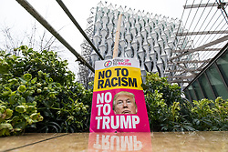 © Licensed to London News Pictures. 20/01/2018. London, UK. An anti-Donald Trump placard in a flowerbed outside the new American Embassy in Nine Elms. Trump has cancelled his planned February 2018 visit to the UK and has described the new embassy as a 'bad deal'. Photo credit: Rob Pinney/LNP