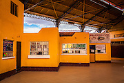 Ticket offices in the bus terminal of La Paz. The terminal was empty, since people after the 4pm of Saturday couldn't travel. During elections period in  Bolivia, the country faces several restrictions, like no alcohol for sale 48 hours before and 12 after the election; no public gatherings, shows of any kind until the political parties made their speeches on the election night; its completely forbidden the circulation of any vehicles, private or governmental except with the permit from the Electoral Tribunal, which means it would be basically no cars, buses or anything circulating in the city; no long distance buses, the terminal will be close from Saturday until Monday and even flights will not be allowed except the ones leaving the country or the international ones doing stop-over. It is a completely shut down of the country.