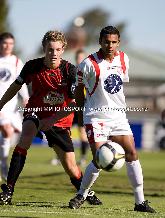 Jade Mesias  with the ball for Waitakere United with Canterbury United player Tristan Nicol behind. Lion Foundation Youth League Final, Canterbury United v Waitakere United, English Park, Christchurch, Sunday 11 April 2010. Photo : Joseph Johnson/PHOTOSPORT