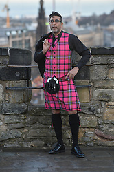 'Still Game' actor Sanjeev Kohli sports the brand new Hogmanay tartan on a photocall on the battlements of Edinburgh Castle.<br /> <br /> © Dave Johnston/ EEm
