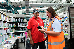 Two delivery offices, Oadby and Leicester South, which are both based inside the Leicester Mail Processing Unit building, have passed the penultimate gateway of One Plan.  One Plan is a business programme designed to have a standardised operation of excellence.  Pictured is Mendeep Singh working with workplace coach Pearl Howard.<br /> <br /> Picture: Chris Vaughan Photography<br /> Date: July 7, 2017