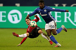 GELSENKIRCHEN, Jan. 22, 2018  Oliver Sorg (L) of Hannover and Breel Embolo of Schalke battle for the ball during the Bundesliga match between FC Schalke 04 and Hannover 96 at Veltins-Arena in Gelsenkirchen, Germany, Jan. 21, 2018. (Credit Image: © Joachim Bywaletz/Xinhua via ZUMA Wire)