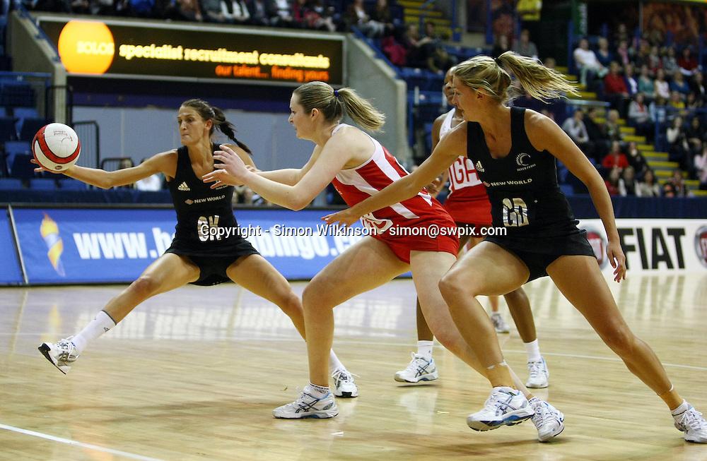 PICTURE BY VAUGHN RIDLEY/SWPIX.COM...Netball - International Netball Series - England v New Zealand - Capital FM Arena, Nottingham, England - 17/01/11...New Zealand's Anna Scarlett beats England's Louisa Brownfield to the ball.