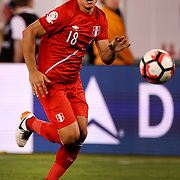 EAST RUTHERFORD, NEW JERSEY - JUNE 17:  Cristian Benavente #18 of Peru in action during the Colombia Vs Peru Quarterfinal match of the Copa America Centenario USA 2016 Tournament at MetLife Stadium on June 17, 2016 in East Rutherford, New Jersey. (Photo by Tim Clayton/Corbis via Getty Images)