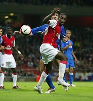 Photo: Chris Ratcliffe.<br /> Arsenal v Dinamo Zagreb. UEFA Champions League, Qualifying. 23/08/2006.<br /> Vedran Corluka of Dynamo Zagreb clashes with Johan Djourou of Arsenal.