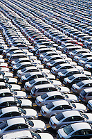 Cars parked in rows elevated view full frame