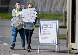 © Licensed to London News Pictures. 28/03/2020. Chessington, UK. Protective equipment supplies are brought to nurses operating a newly opened drive through virus testing centre for NHS staff in the car park of Chessington World of Adventures. Death rates from the spread of coronavirus continue to climb. Both the Prime Minister Boris Johnson and Health Secretary Matt Hancock have tested positive for the virus and are now self isolating. Photo credit: Peter Macdiarmid/LNP