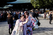 JANUARY 09: Japanese women who celebrate turning 20 years old, clad in Japanese kimono, take a selfie during a coming of age ceremony at Meiji Jingu shrine in Tokyo, on Coming of Age Day national holiday, Monday, Jan. 9, 2017. While many festive ceremonies are held in various venues throughout Japan, The day is marked by those who turned 20 in the past year after April 1 or will be 20 before March 31 this year. 09/01/2017-Tokyo, JAPAN