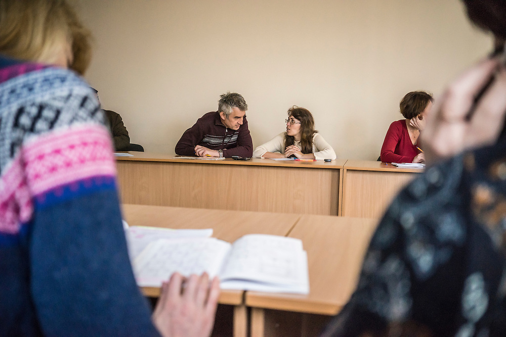 Students, many of whom are IDPs from eastern Ukraine, in a Polish language class on Tuesday, April 28, 2015 in Lviv, Ukraine. The teacher is Ewa Holodkova, 67, from the town of Stakhanov in Lugansk oblast, who despite being a Polish citizen and she and her husband having the legal right to live in Poland, where they have a daughter, cannot afford to move there because their Ukrainian pensions are too small to afford life in Poland. CREDIT: Brendan Hoffman/Prime for the Wall Street Journal UKRMIGRATION CREDIT: Brendan Hoffman/Prime for the Wall Street Journal UKRMIGRATION