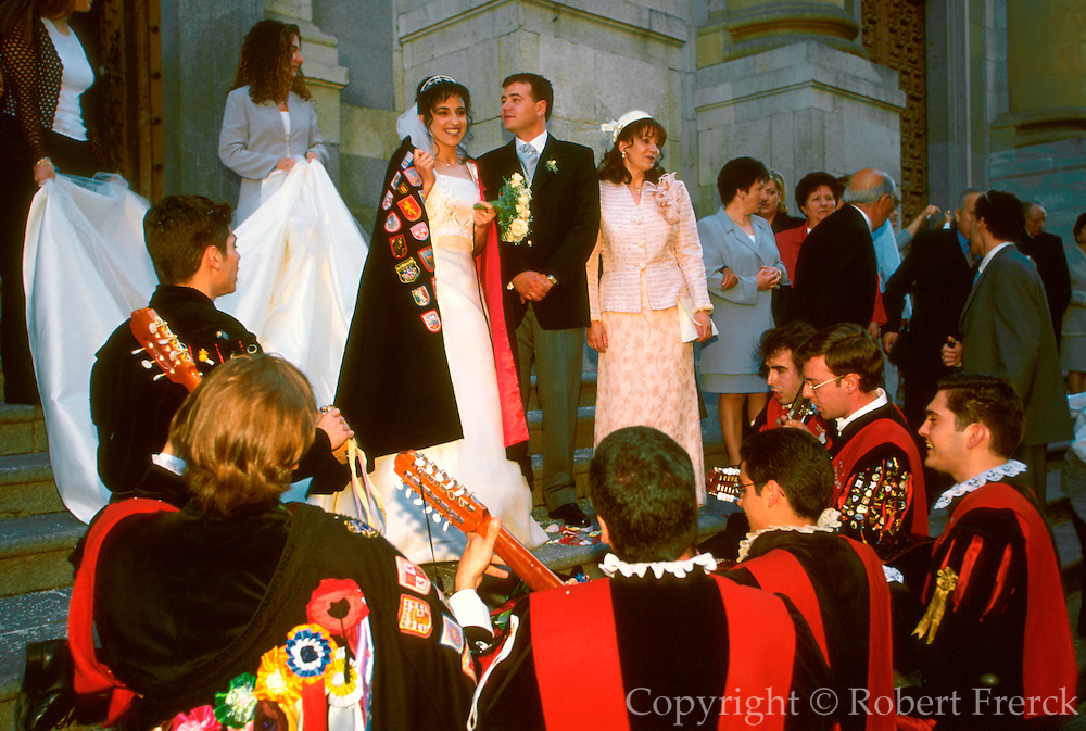 SPAIN, CASTILE, SALAMANCA bride and groom serenaded by 'Tuna'