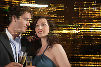 Young Couple Drinking Champagne Against Night Skyline Close-up