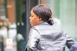 Millicent Barnes, 21,  does her best to avoid photographers as she leaves Westminster Magistrates Court at lunchtime where she faces charges of threatening violence against a woman at Oxford Circus Tube Station after the woman's baby kicked her. London, August 28 2018.