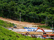 09 AUGUST 2018 - KAENG KRACHAN, PHETCHABURI, THAILAND: Emergency spillways under construction for the Kaeng Krachan Dam. The Phetchaburi River flows from Kaeng Krachan Dam to the Gulf of Siam through several towns including Ban Lat, Phetchaburi (the capital of Phetchaburi province) and Ban Laem. Government officials have warned residents of those towns that their towns will flood because the reservoir behind the dam is approaching capacity. Ban Lat and Phetchaburi could be flooded for several weeks. Residents of Ban Laem have been warned that their community could be inundated for over a month. Dams in Kanchanaburi province, west of Phetchaburi, are also approaching capacity and flooding is also expected in that area.   PHOTO BY JACK KURTZ
