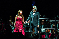 ANAHEIM, CA - JUN 9: Italian tenor Andre Bocelli performed Granada, New York, La Boheme, LaTraviata among others keeping audience mesmerized at the Honda Center in Anaheim, CA. The magical night included producer David Foster on Piano, Violinist Caroline Campbell, American Idol Season 3 winner Soul Singer Fantasia, Cuban Soprano Maria Aleida and Orchestra Conductor Eugene Kohn. Italian tenor Andre Bocelli (R) performs with Cuban soprano Maria Aleida (L). All fees must be agreed prior to publication, Byline and/or web usage link must  read  PHOTO: SilvexPhoto.com