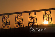 Sunset over a still active railroad tower and girder bridge called the Joso High Bridge.