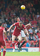 August 19th 2017, Pittodrie Stadium, Aberdeen, Scotland;  Scottish Premiership football, Aberdeen versus Dundee; Dundee's Cammy Kerr beats Aberdeen's Mark Reynolds in the air