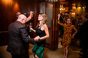 Photo by Matt Roth<br /> Assignment ID: 30148071A<br /> <br /> David Hagedorn, dances with Amanda McClements, a fellow food writer, during his and Michael Widomski's, background, wedding reception at Fiola Restaurant in Washington, DC, Sunday, September 22, 2013. Nycci Nellis, another food writer, background, approaches the dance floor.