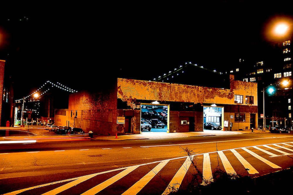 View of a garage by night on Front street in DUMBO, Brooklyn, with the lights of the Manhattan bridge, New york, 2008.
