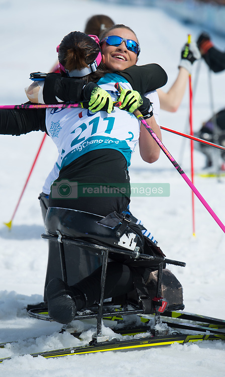 March 17, 2018 - Pyeongchang, South Korea - Oksana Masters of the US (facing) embraces Marta Zainullina of Neutral Paralympic Athletes after Masters won gold in the 5km Sitting Cross Country event Saturday, March 17, 2018 at the Pyeongchang Winter Paralympic Games. Zainullina took bronze. Photo by Mark Reis (Credit Image: © Mark Reis via ZUMA Wire)