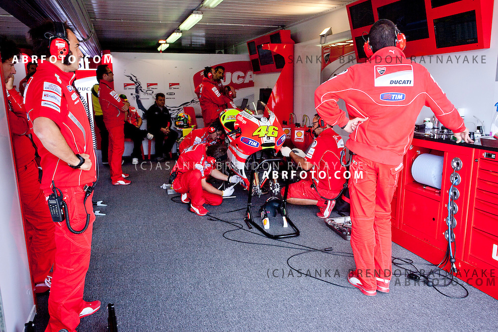 15 October 2011: Team Ducati's pit crew working on Valentino Rossi's (46) bike in the pit garage during Moto Gp qualifying at the Phillip Island Circuit in Phillip Island, Victoria, Australia.
