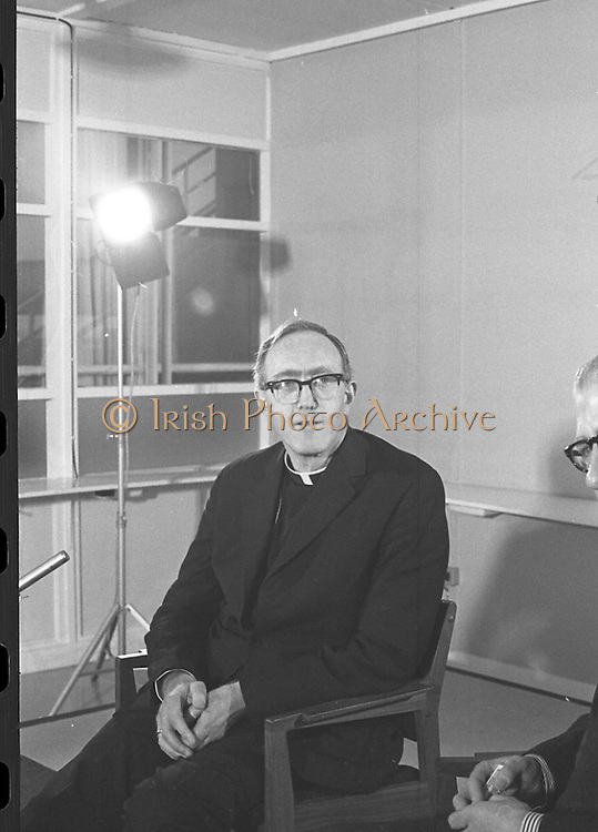 Archbishop Ryan Returns From Rome..1972..16.02.1972..02.16.1972..16th February 1972..After his official appointment as Archbishop of Dublin by Pope Paul VI, Dr Dermot Ryan returned to Dublin for his installation as Archbishop on Feb 22nd at the Pro Cathedral,Dublin..Photograph of Dr Dermot Ryan,newly appointed Archbishop of Dublin,taking questions at his press conference in Dublin Airport.