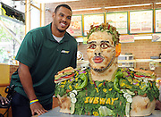 Anthony Barr, 2014 draft prospect and newest SUBWAY Famous Fan, poses with a life-size food statue made of fresh vegetables, Wednesday, May 7, 2014, in New York. Barr joins a roster of fellow Famous Fans that include Robert Griffin III, Justin Tuck, Russell Westbrook, Pele and Michael Phelps. (Photo by Diane Bondareff/Invision for SUBWAY/AP Images)