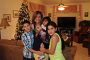 "Coral Springs, FLA 123112  New Year's eve at la casa de los suegros, Ana Ma y Don Freddy, with Freddy ""El Nino,"" Alvaro, Raquel, Alvarin, Ana Carolina, Dafne, Juan y Alana. Essdras y Sara. (Essdras M Suarez/ EMS Photography)"