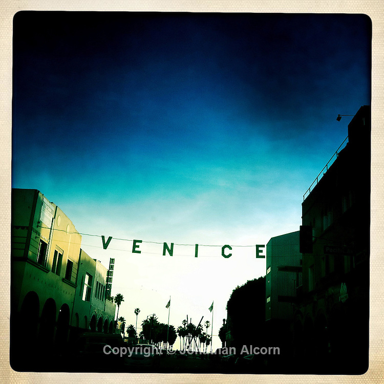 The Venice sign sprawls across Windward Ave at Pacific St in Venice Beach . Photographed with the hipstamtatic app in Venice Beach