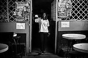 Priscilla, aged 26, at local bar 'Bobs' in Mugumoini Village slum where she works as a waitress when she is not seeing clients as a prostitute. Raped by 2 men on her way home one night after a party with friends she was left abandoned on the roadside, drunk and naked. A woman from the Kenya Wildlife Service found her the next day and took her home. She has continuous health problems as a result forcing her to make regular visits to the local community health centre. She has been an inspiration to other raped women in the community and continues to come forward.<br />