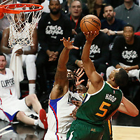 25 April 2017: Utah Jazz guard Rodney Hood (5) goes for the lay up over LA Clippers center DeAndre Jordan (6) during the Utah Jazz 96-92 victory over the Los Angeles Clippers, during game 5 of the first round of the Western Conference playoffs, at the Staples Center, Los Angeles, California, USA.