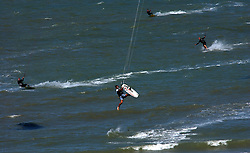 KNOKKE, BELGIUM - JULY-30-2005 - Sailboarders fly through the air as they play in the waters of the North Sea in Knokke. (Photo © Jock Fistick)
