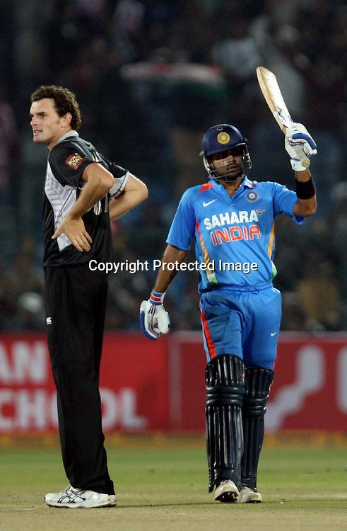 Indian batsman Virat Kohli celebrates half century against New Zealand during the 2nd ODI india vs New Zealand Played at Sawai Mansingh Stadium, Jaipur, 1 December 2010 - day/night (50-over match)